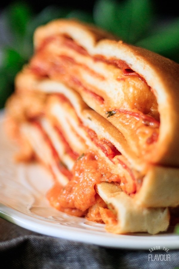 closeup of cheesy pepperoni garbage bread