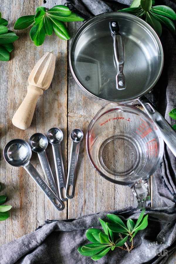 saucepan, citrus reamer, measuring cup, measuring spoons