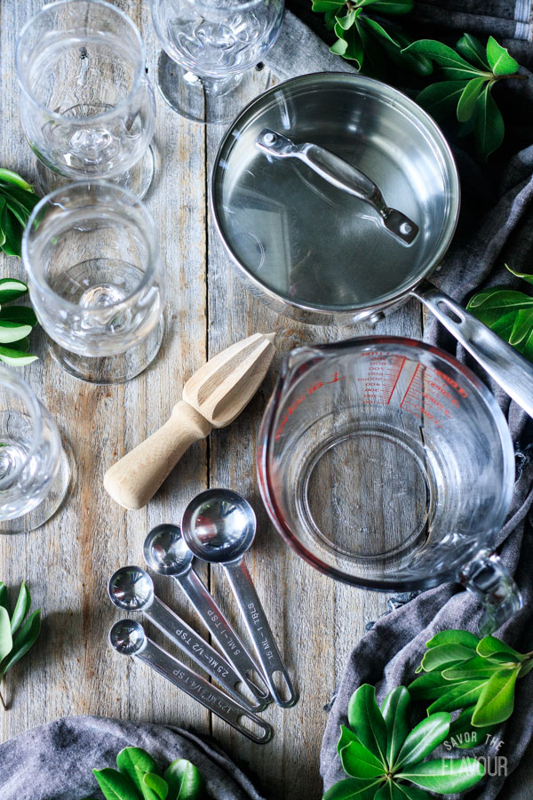 pot, glasses, measuring spoon, citrus reamer, and measuring cup