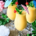 three glasses of frozen mango daiquiri