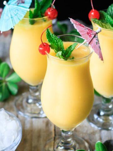 three glasses of frozen mango daiquiri