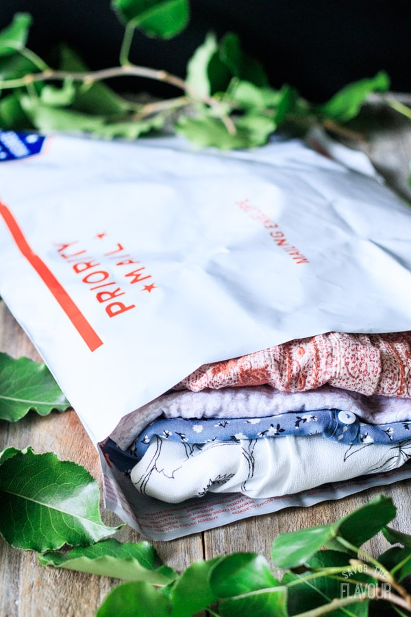 folded clothes inside of a mail envelope