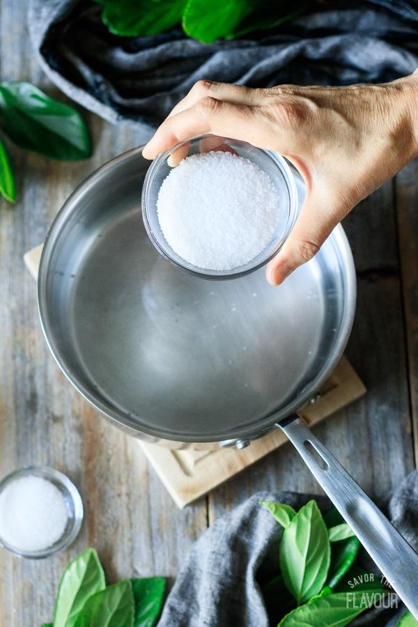 adding salt to the vinegar brine