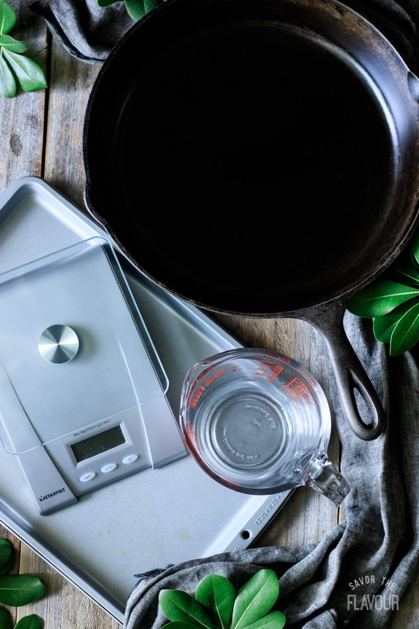 cast iron skillet, scale, measuring cup, and baking sheet