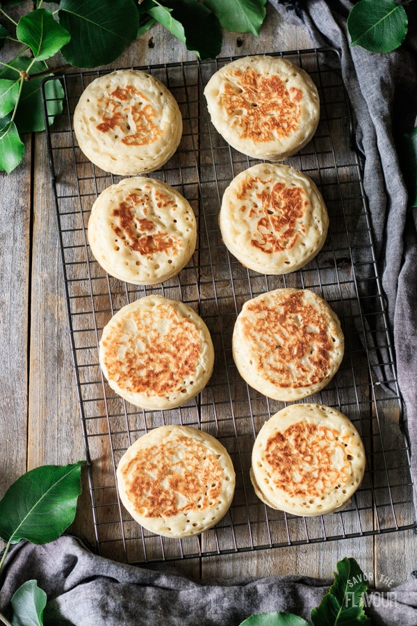 cooked crumpets on a wire rack