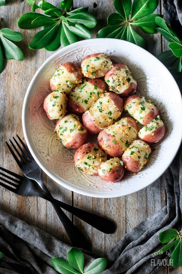 bowl of parsley potatoes with two forks