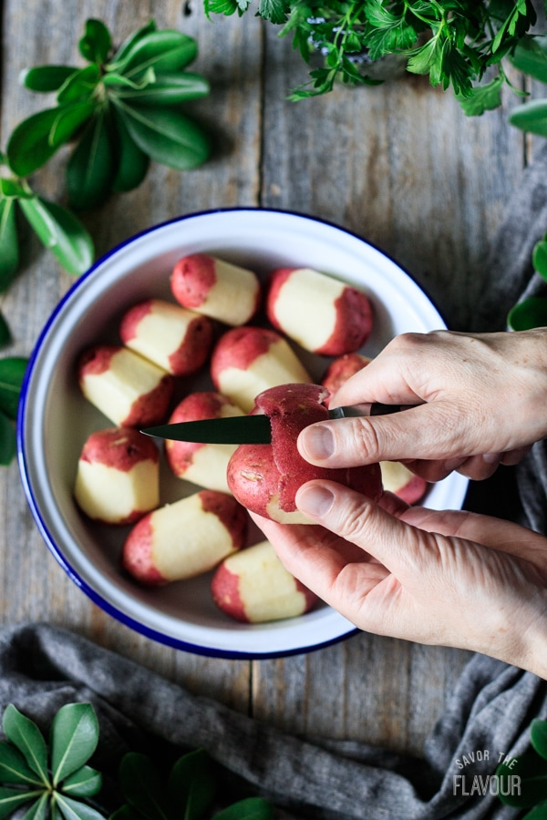 peeling red potatoes with a paring knife