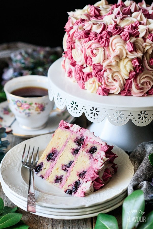 slice of lemon blueberry cake with the cake