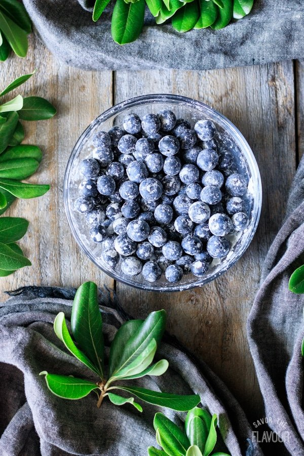 bowl of fresh blueberries tossed in flour