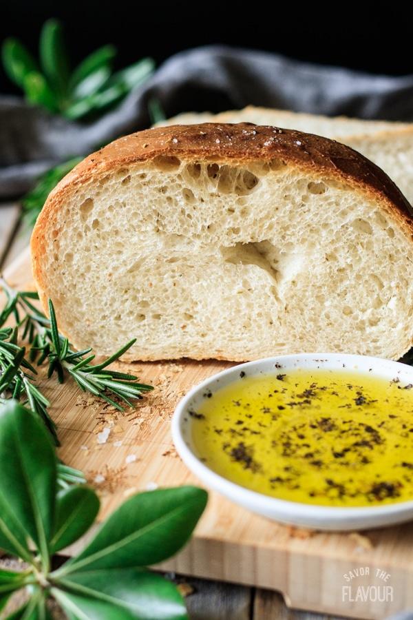 loaf of rosemary bread sliced in half