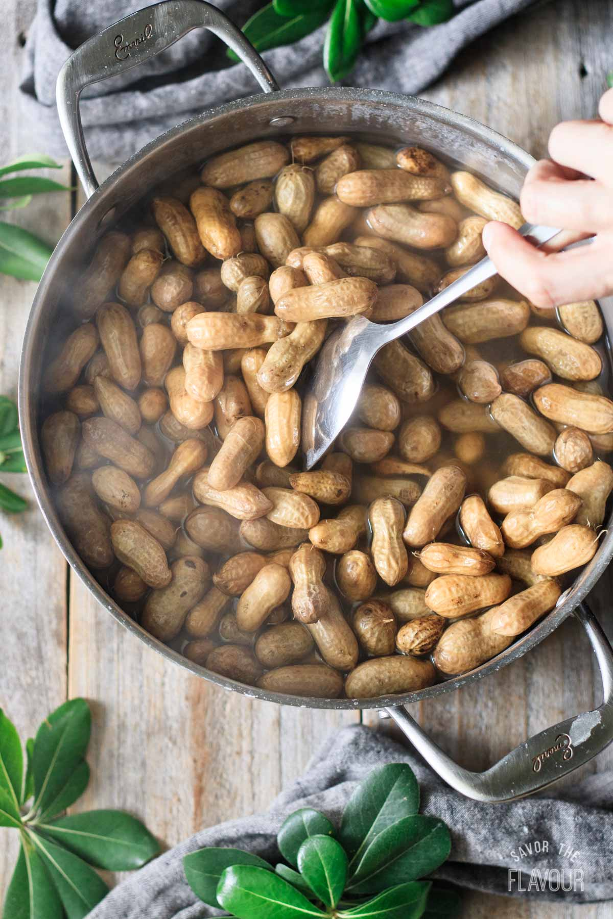 stirring a pot of boiled peanuts
