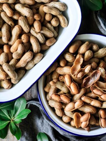 two dishes of boiled peanuts