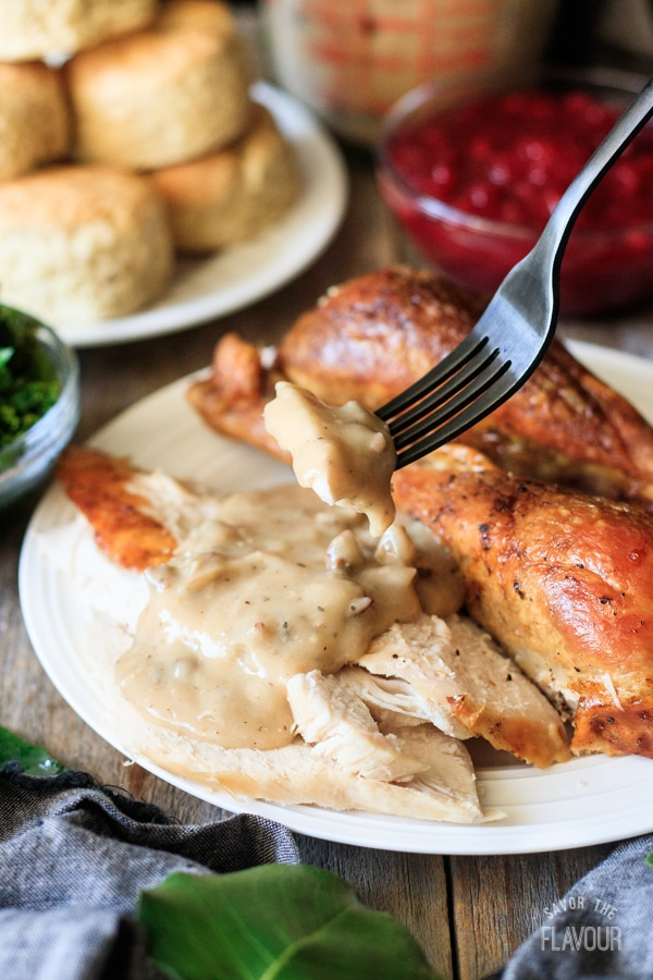 holding a forkful of turkey topped with giblet gravy