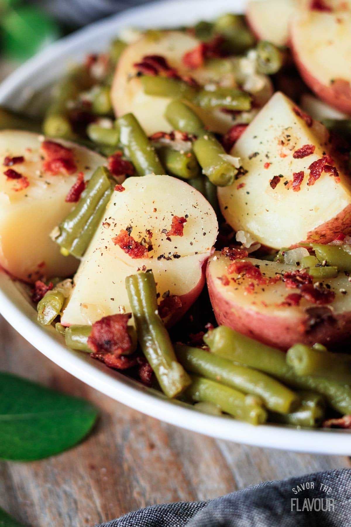 green beans and potatoes with bacon and black pepper