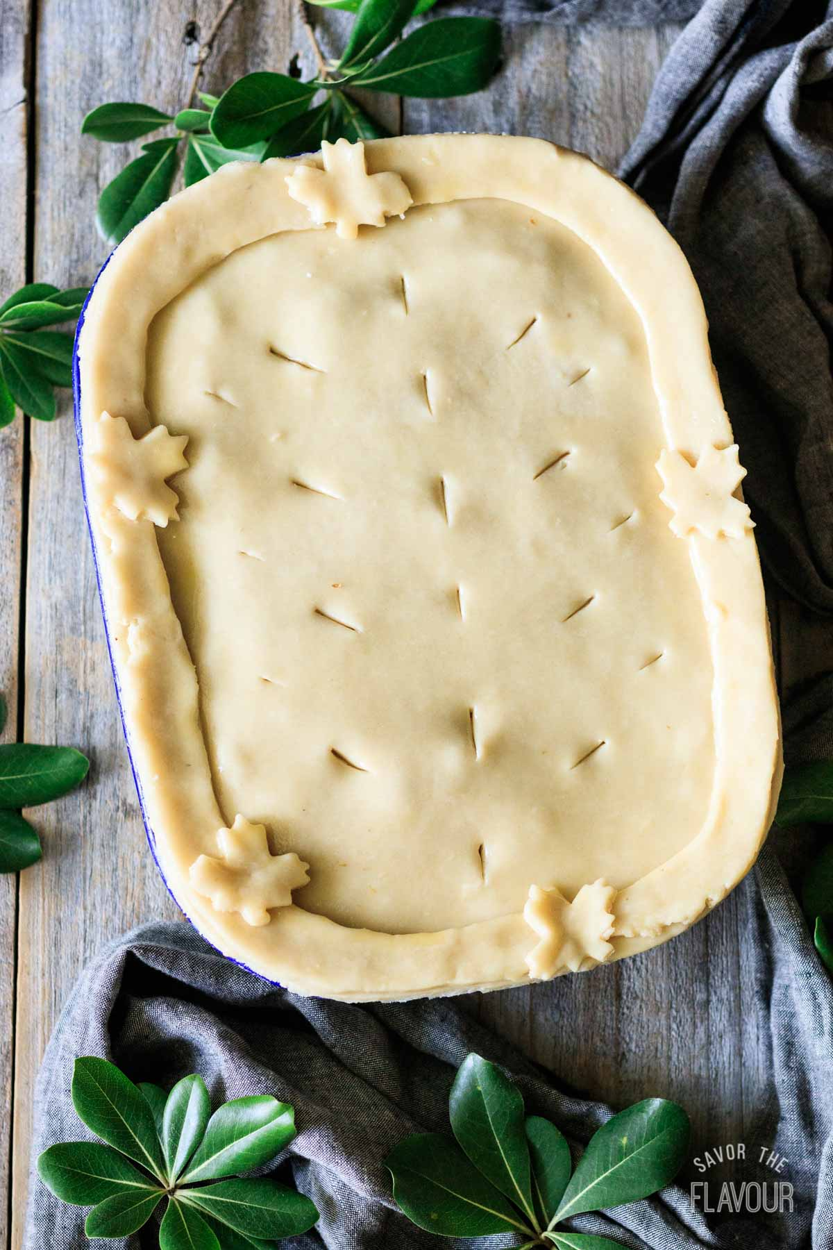 raw puff pastry on top of a pie