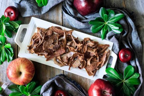 plate of apple peel chips with apples