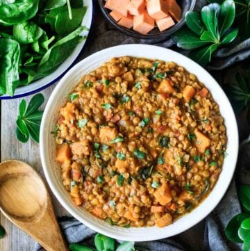 bowl of Moroccan lentil stew with a wooden spoon