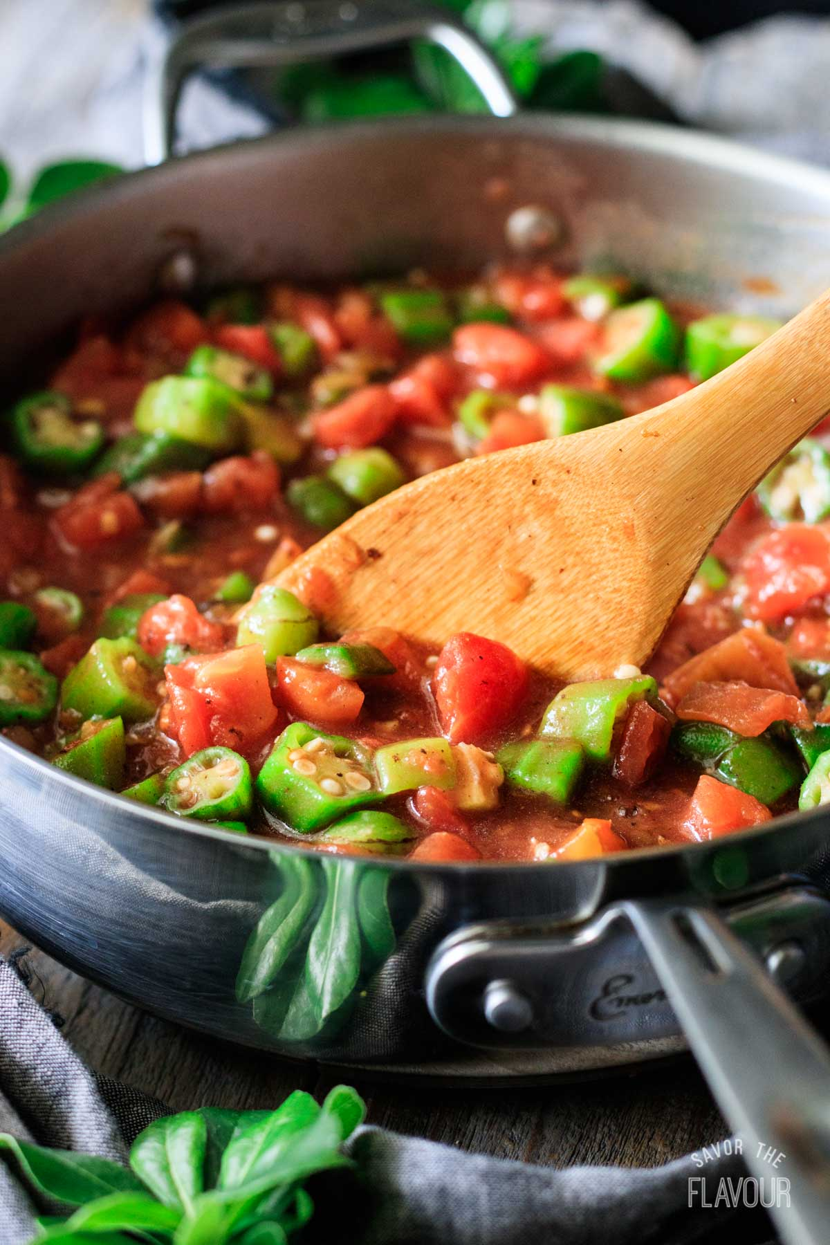 stirring the okra and tomatoes