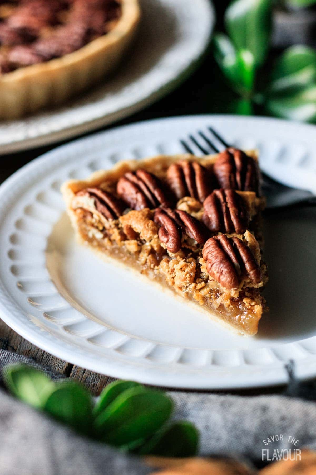closeup of a slice of pecan pie