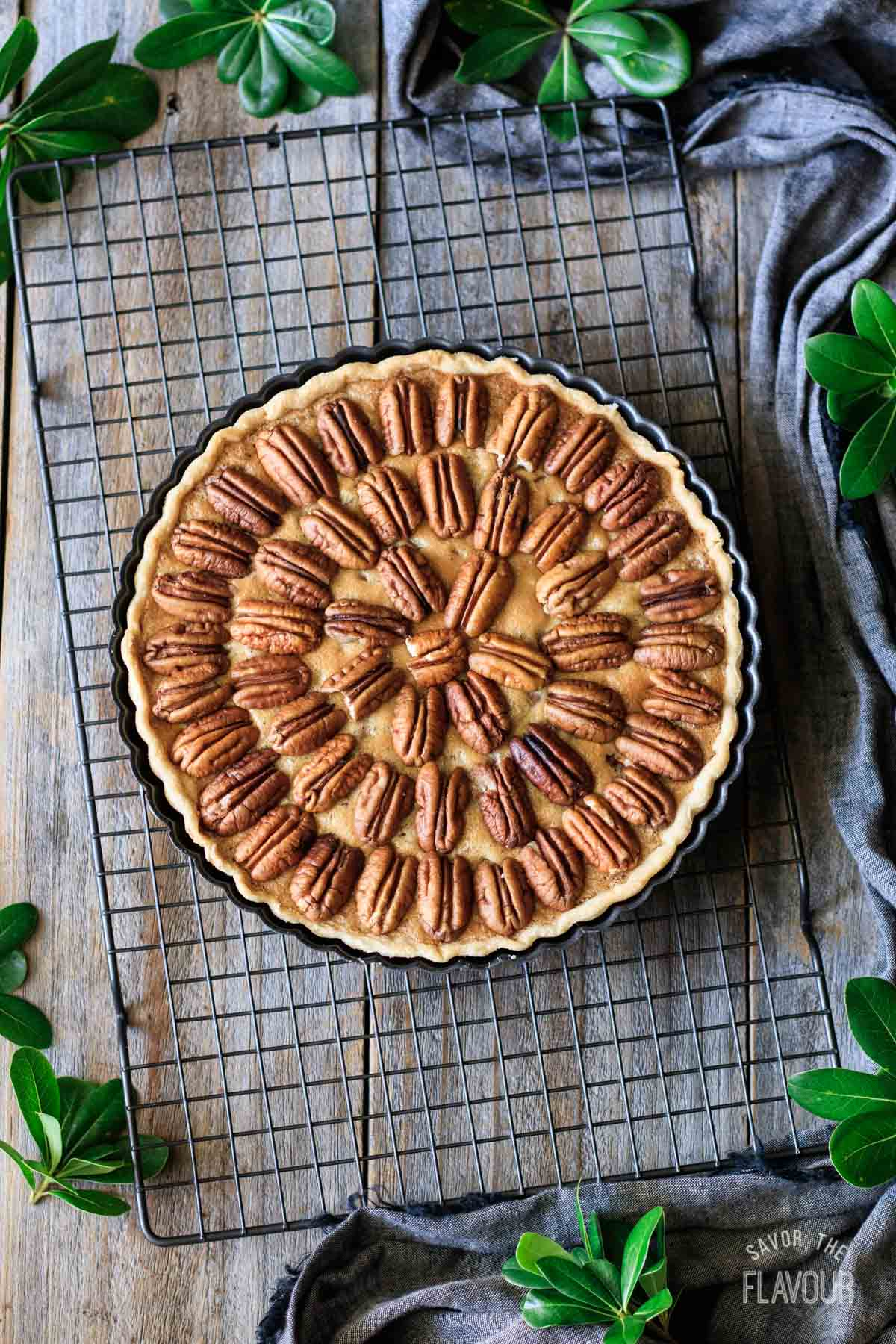 putting pecans on top of pecan pie