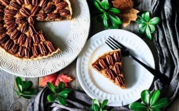 slice of pecan pie on plate with a fork