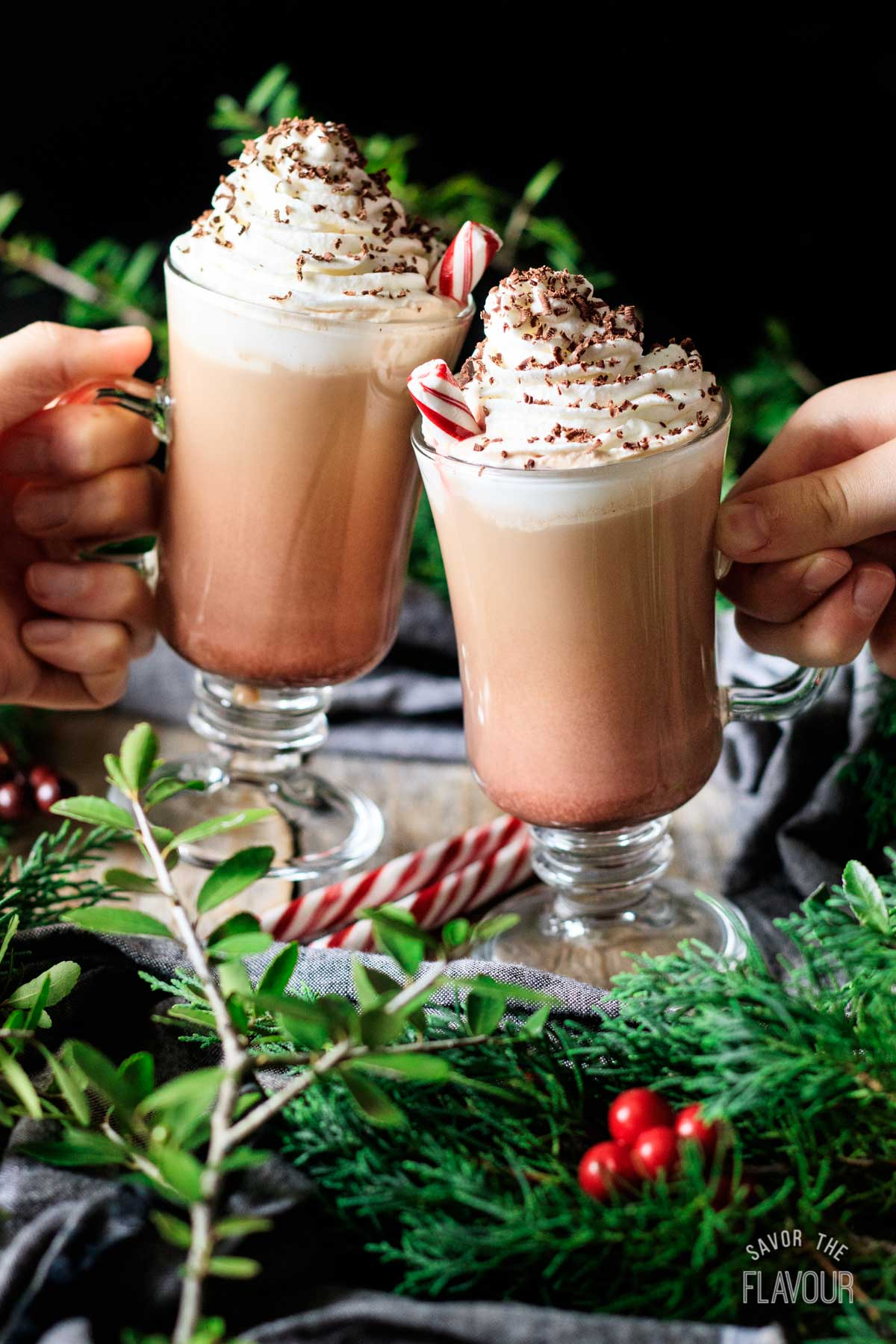 people doing a toast with two peppermint mochas