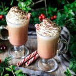 two glasses of peppermint mocha with peppermint sticks