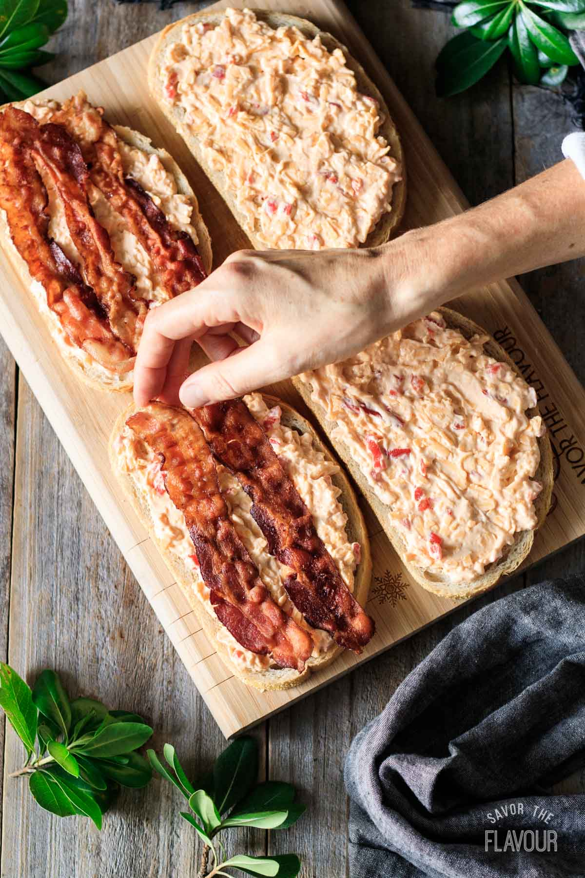 putting bacon on pimento cheese sandwiches