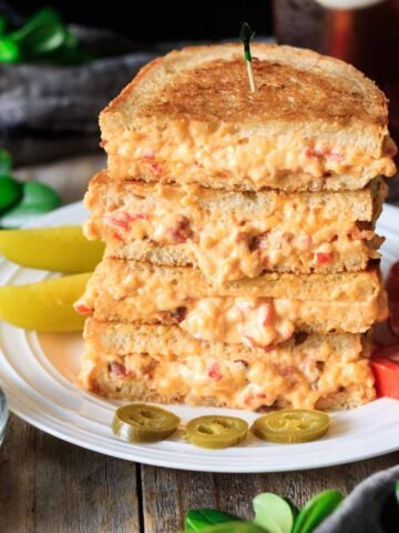 stack of pimento cheese sandwiches with jalapenos