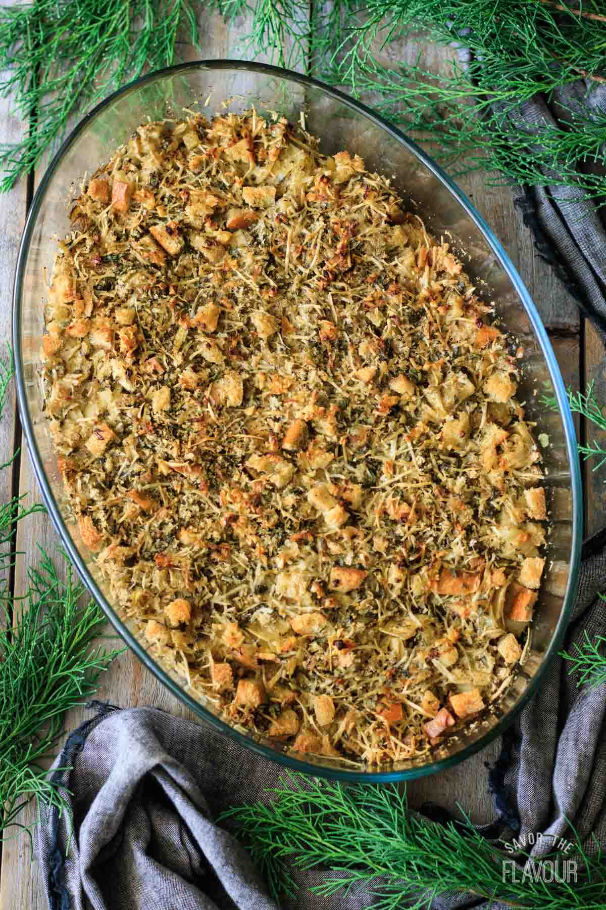 baked artichoke hearts in a casserole dish