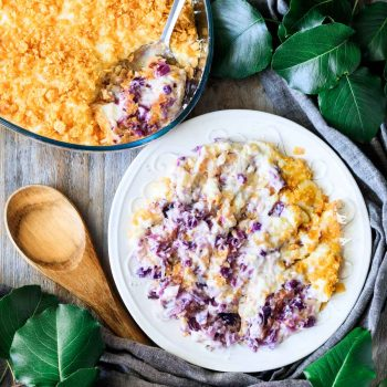 plate of cabbage casserole with a wooden spoon