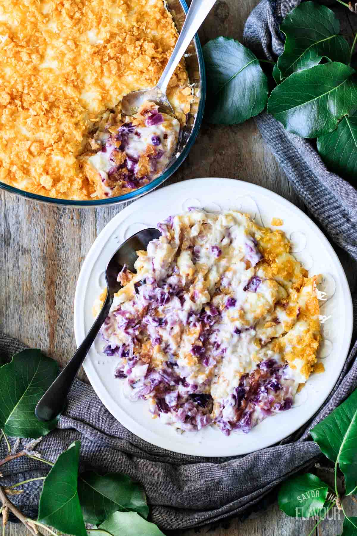 plate of cabbage casserole with the casserole dish
