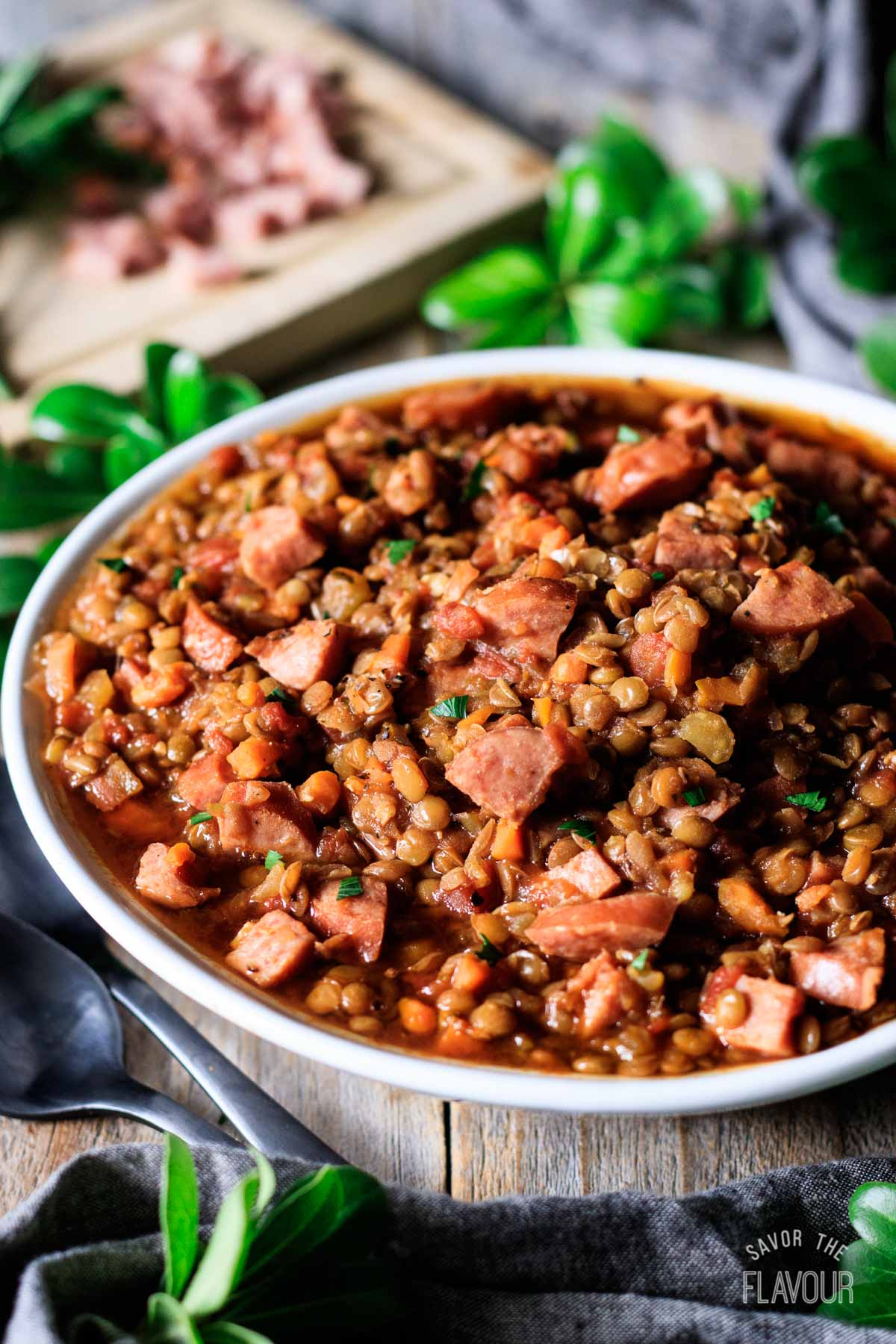 bowl of lentil stew with kielbasa sausage