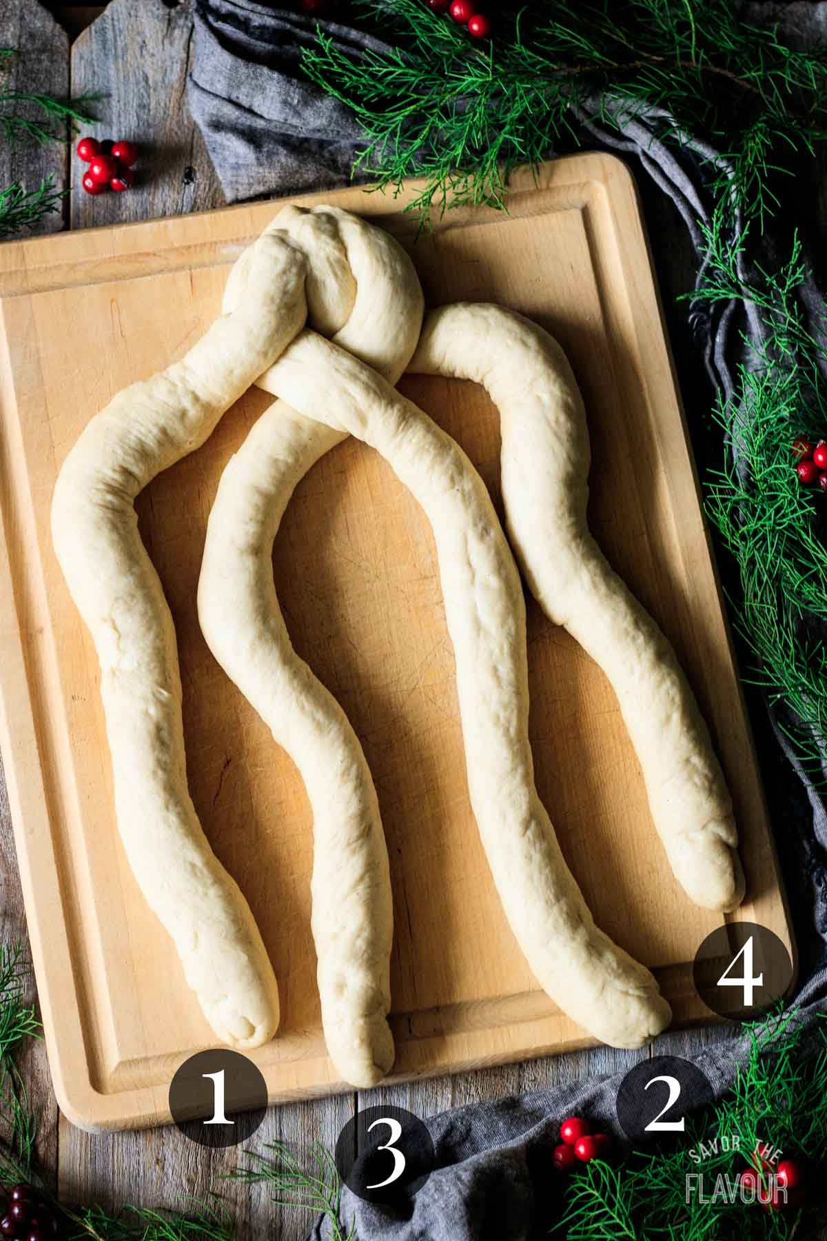 third step in braiding pulla bread