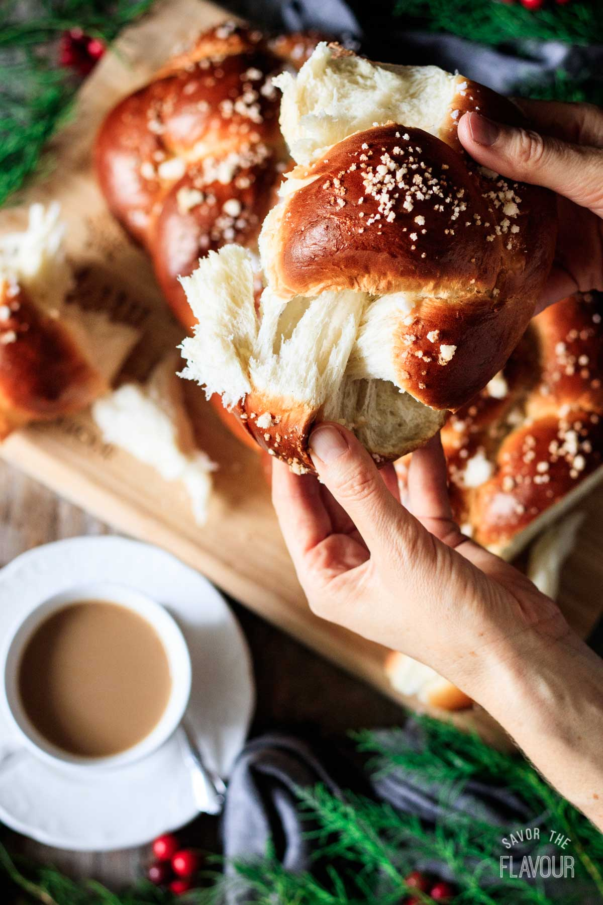 person pulling apart a piece of pulla bread