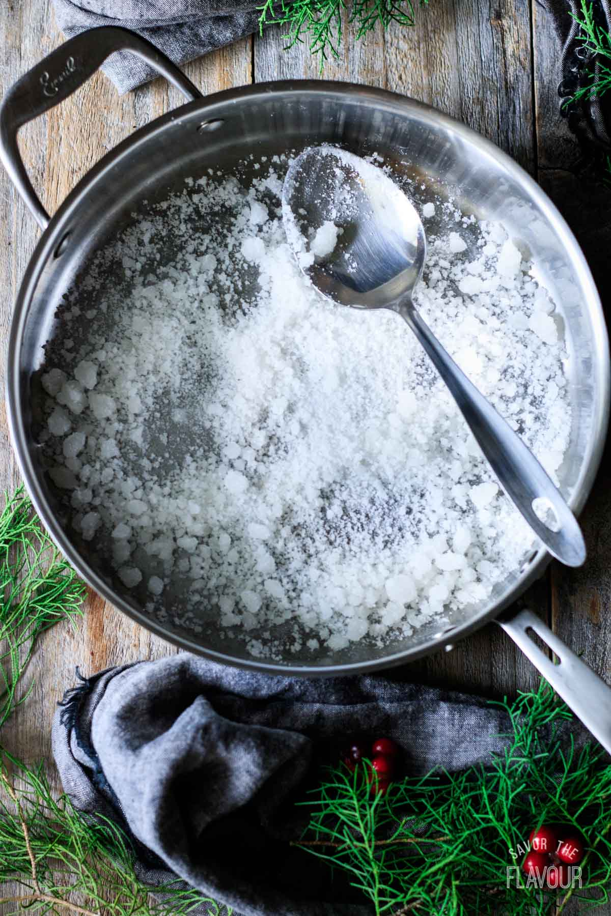 homemade pearl sugar in a skillet with a spoon