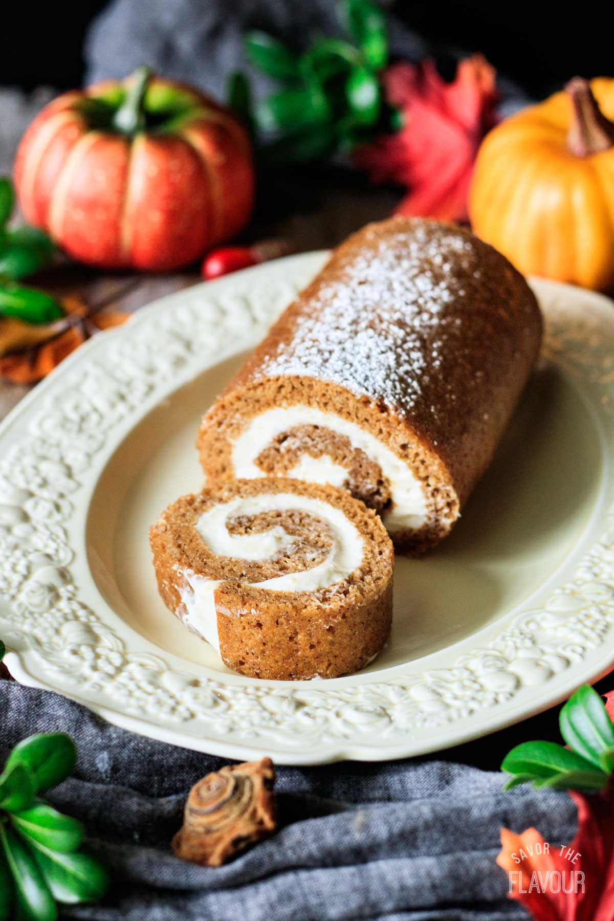 slice of pumpkin roll with the cake