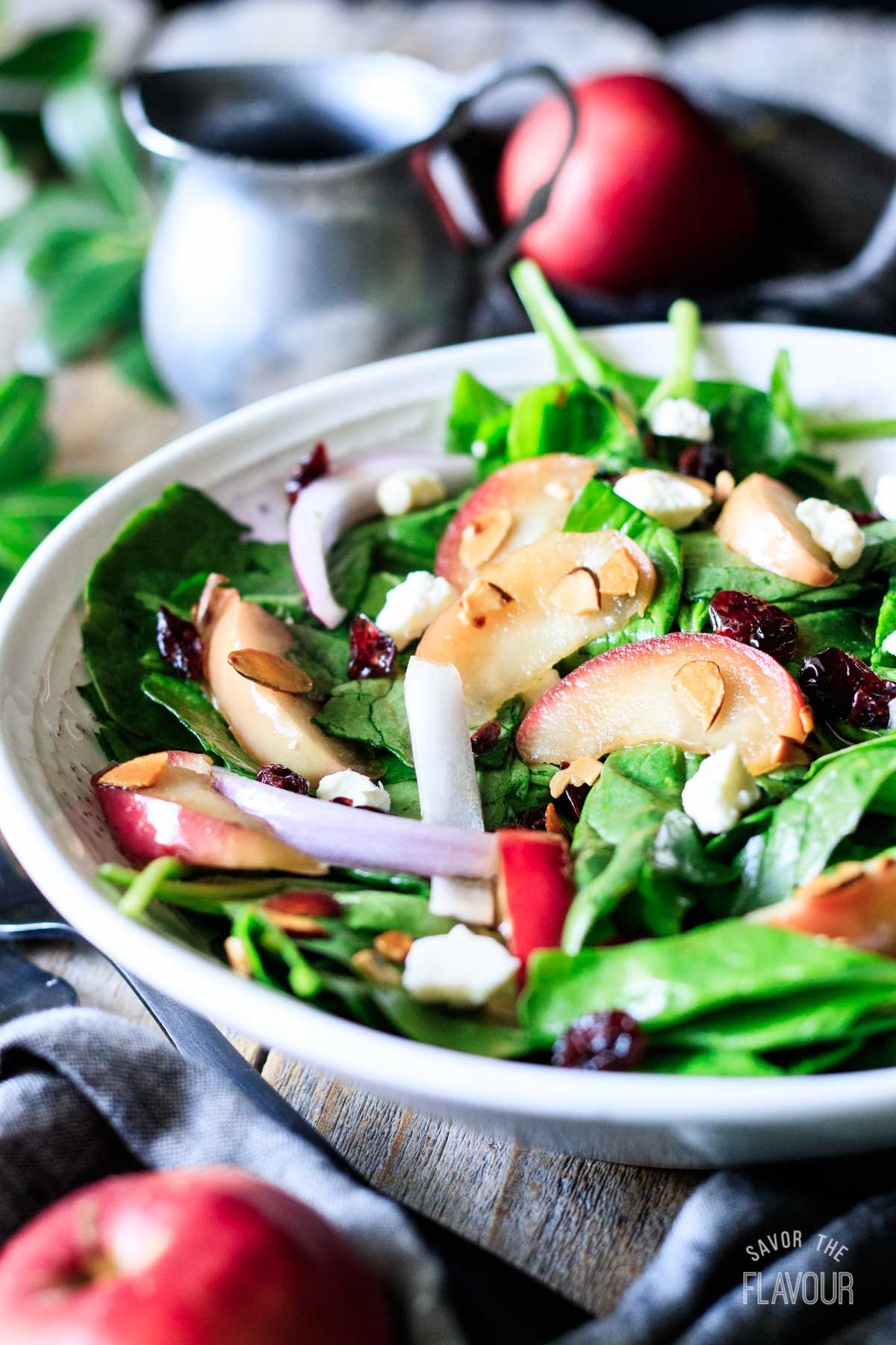 closeup of a bowl of spinach apple salad