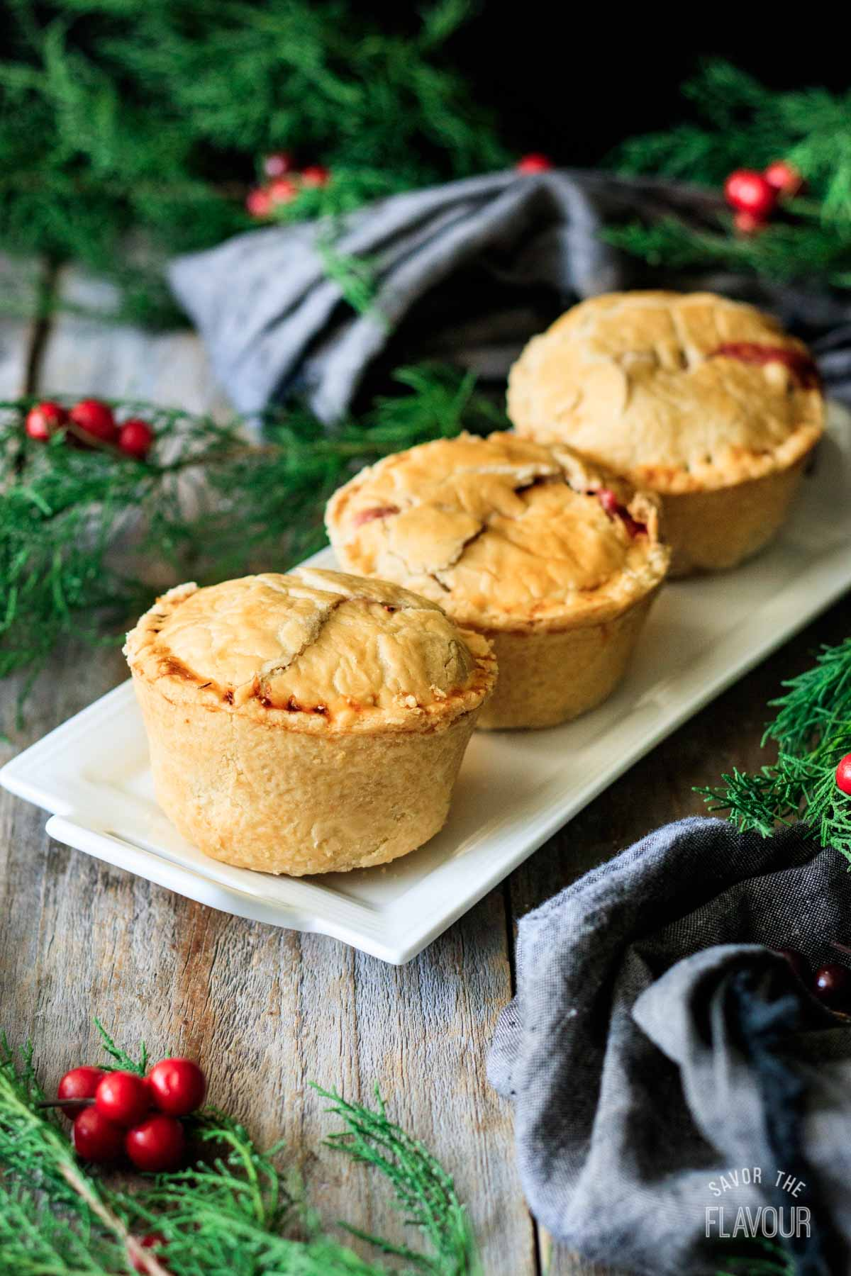 three turkey cranberry pies on a plate