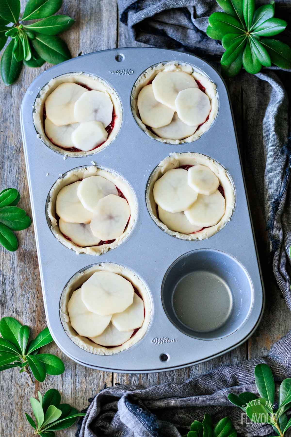 turkey cranberry pies with second potato slice layer