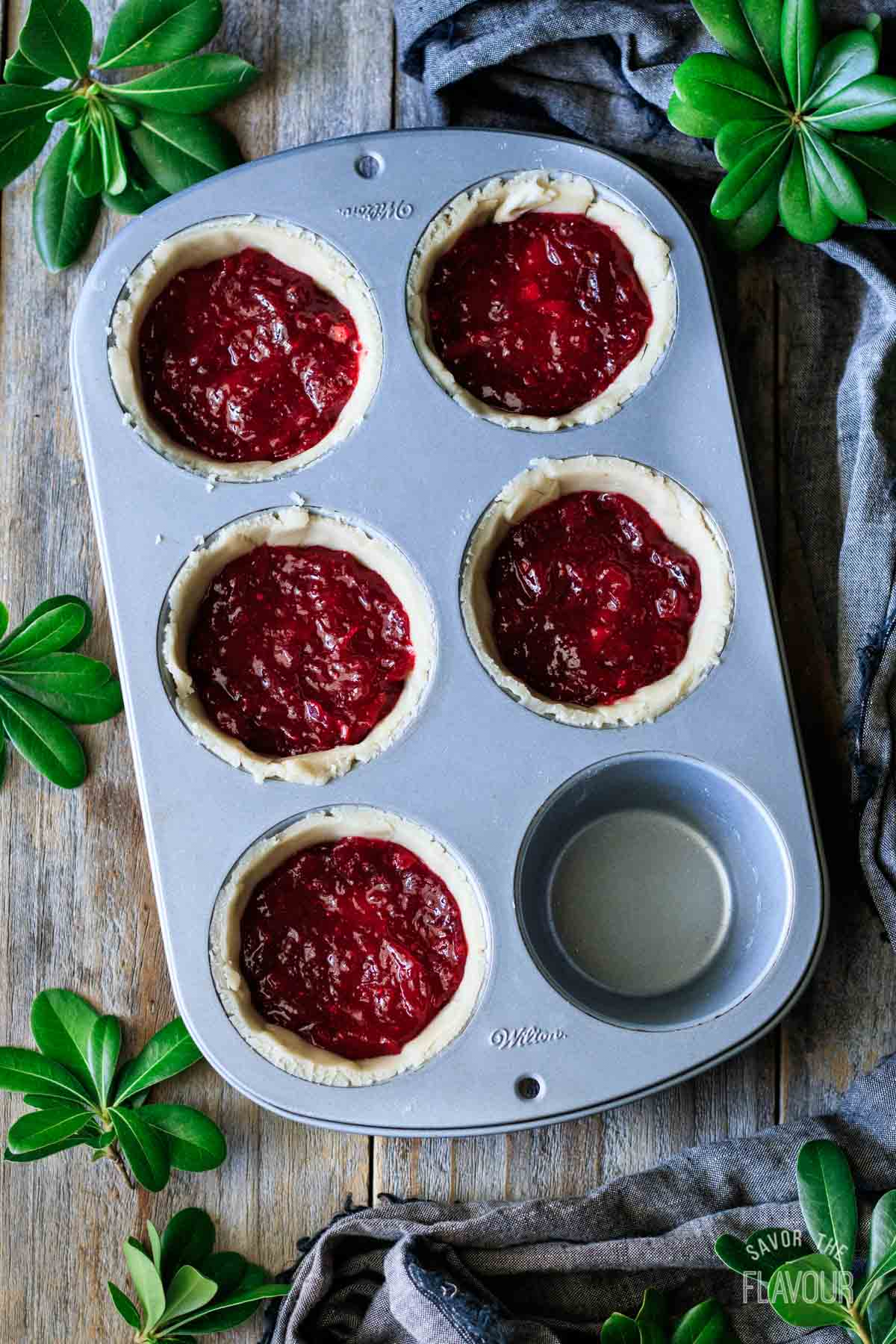 turkey cranberry pies with cranberry sauce layer