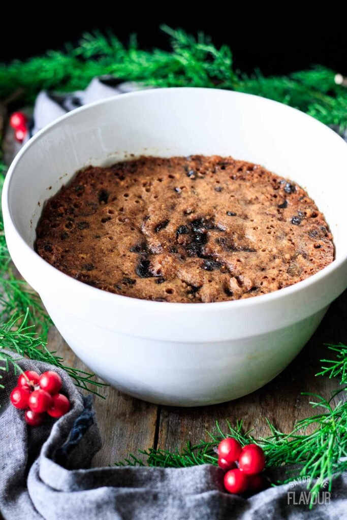 figgy pudding with greenery and red berries
