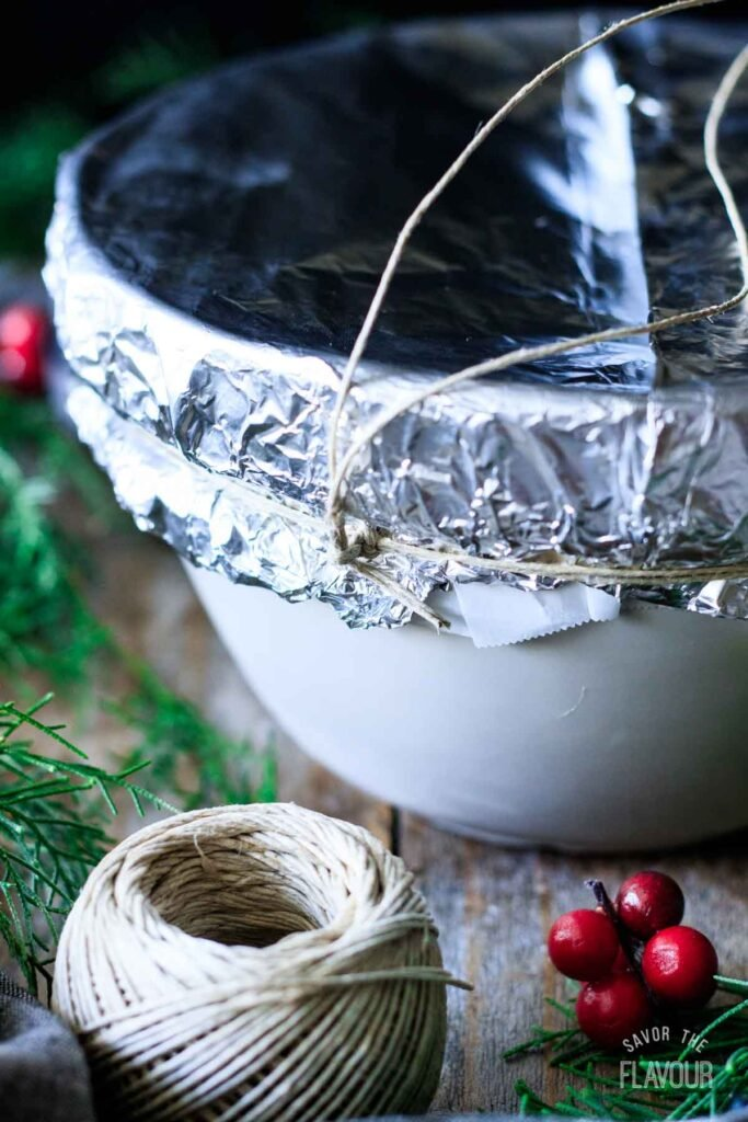 tying the string handle onto figgy pudding