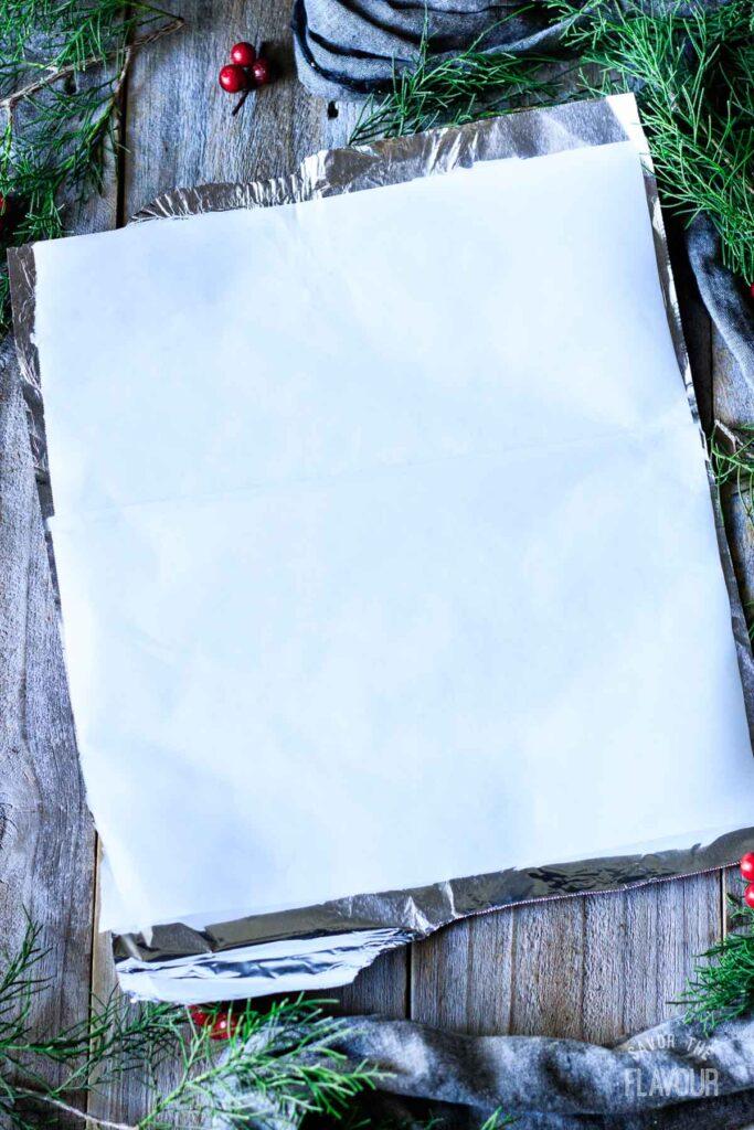 sheet of aluminum foil and parchment paper