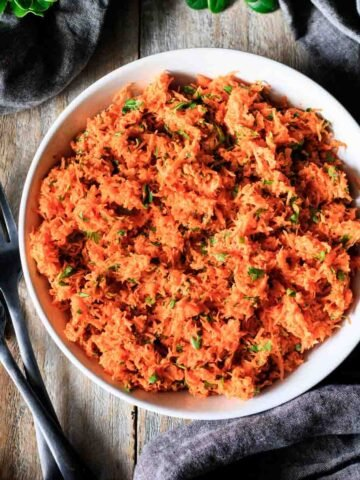 bowl of French carrot salad with two forks