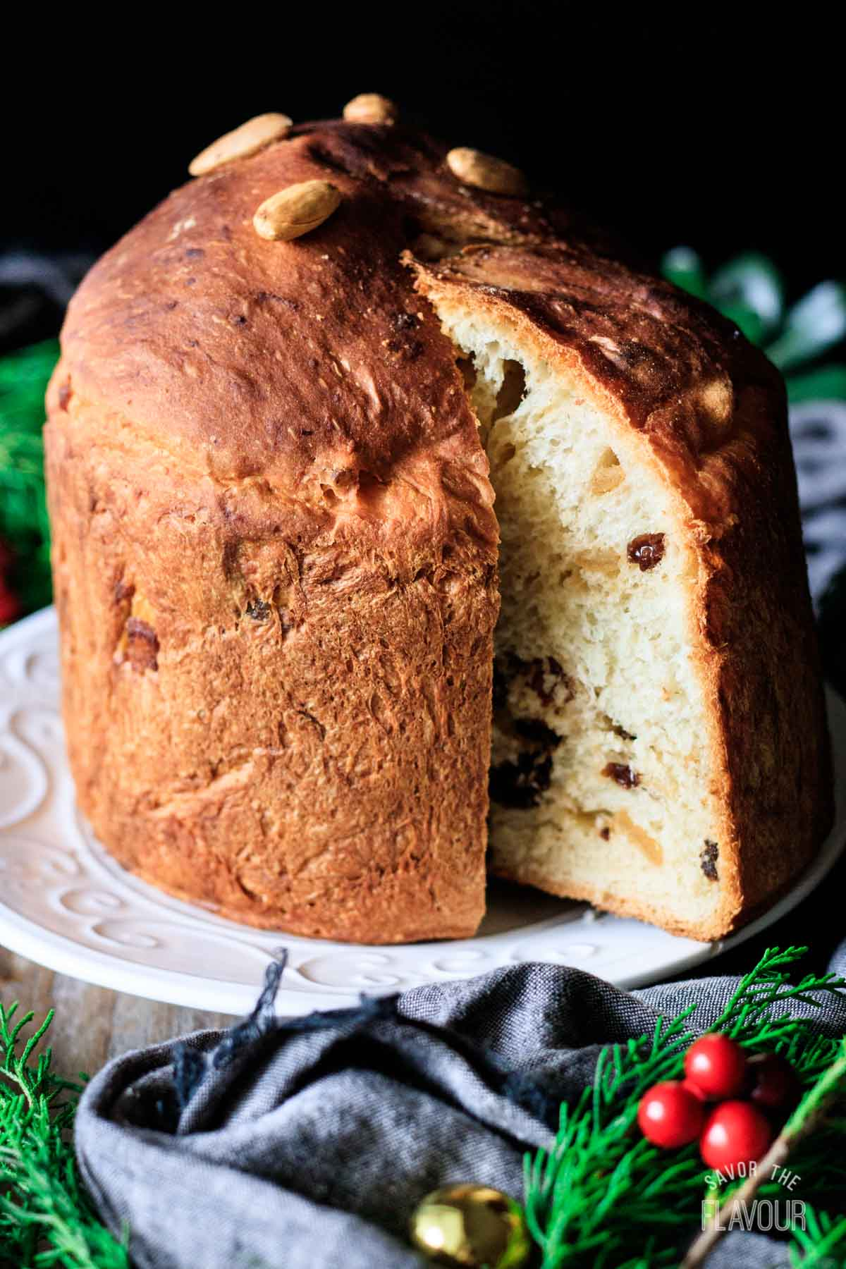 slice of panettone on a plate with the loaf