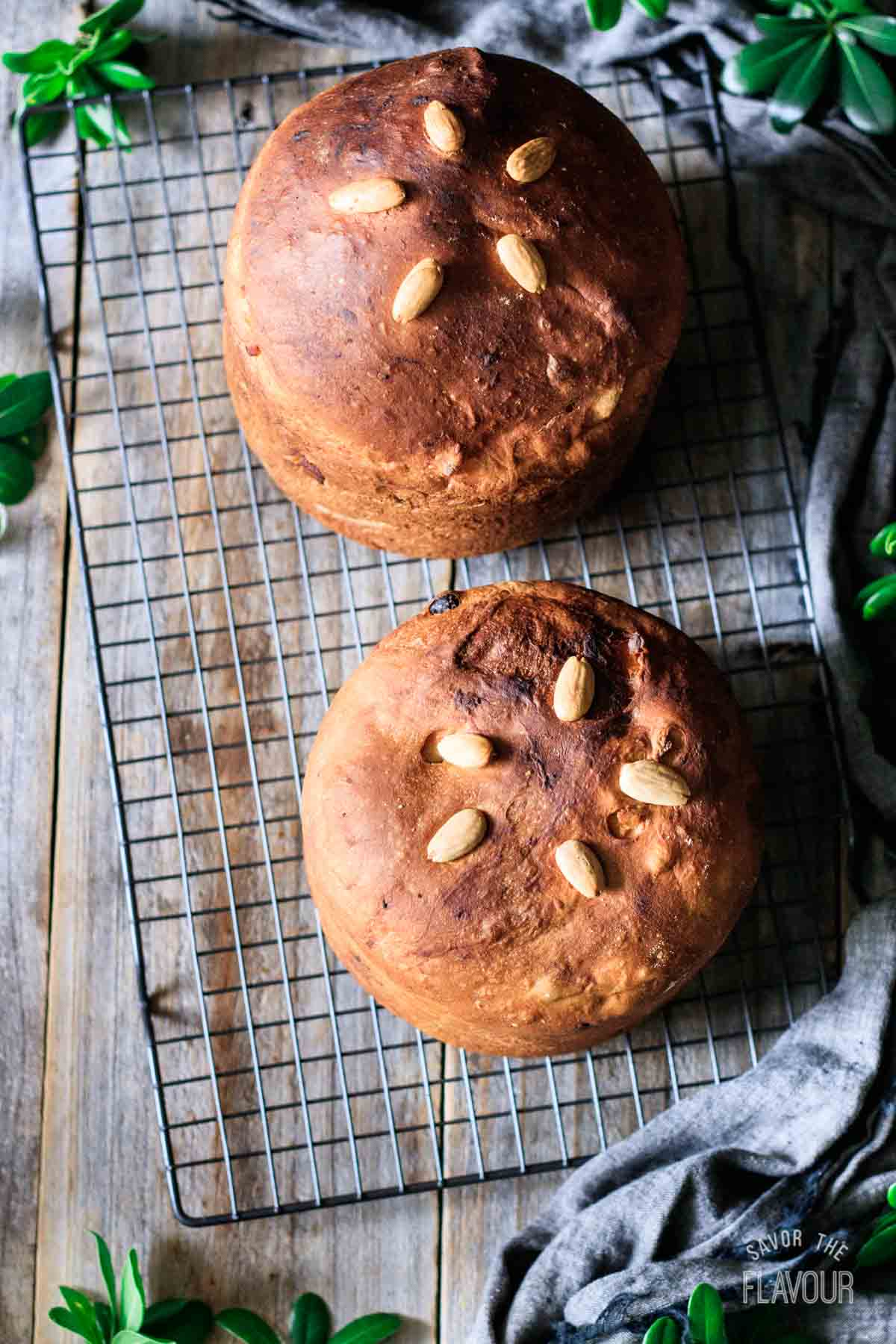 baked panettone loaves on a cooling rack