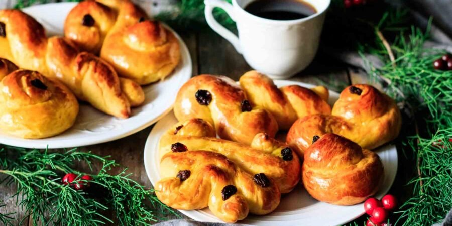 plate of St. Lucia buns with a cup of coffee