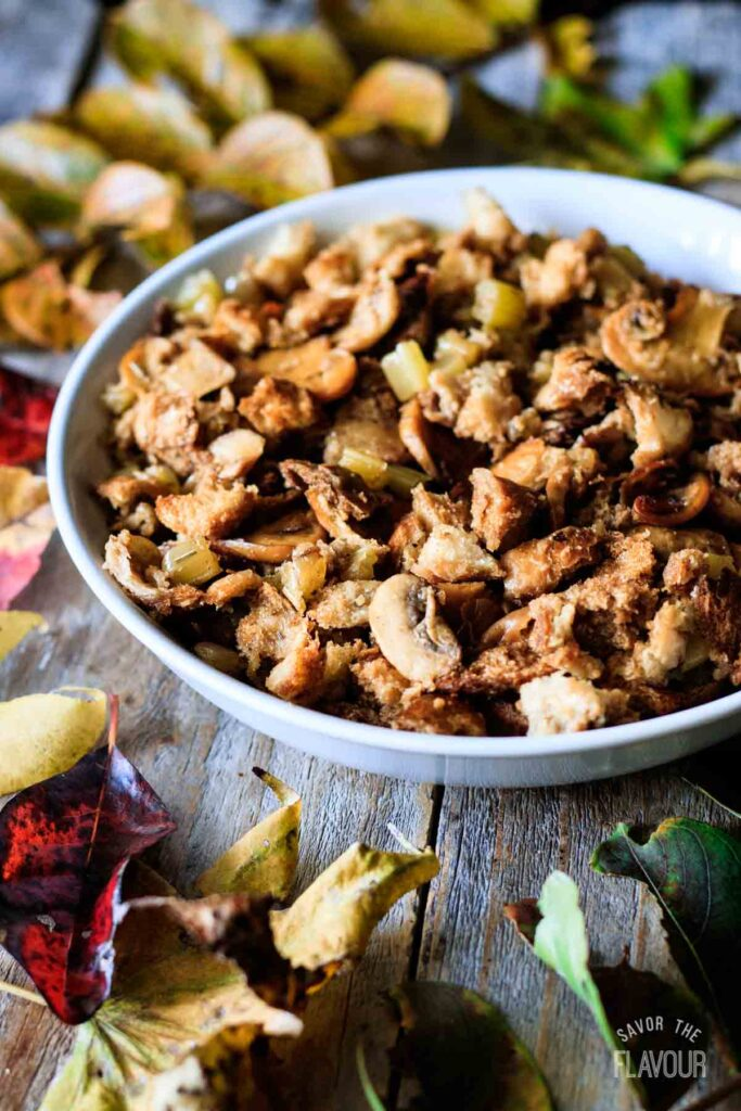 bowl of turkey stuffing with fall leaves