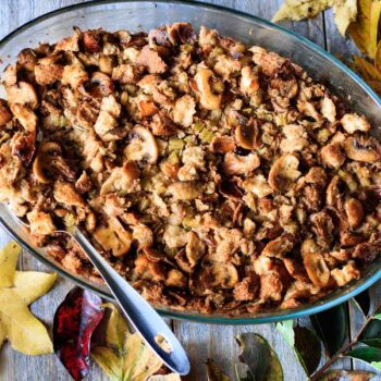 pan of turkey stuffing with a spoon